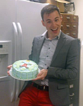 Collin with a cake expertly decorated by Caleb Brown, in celebration of completing his MSc